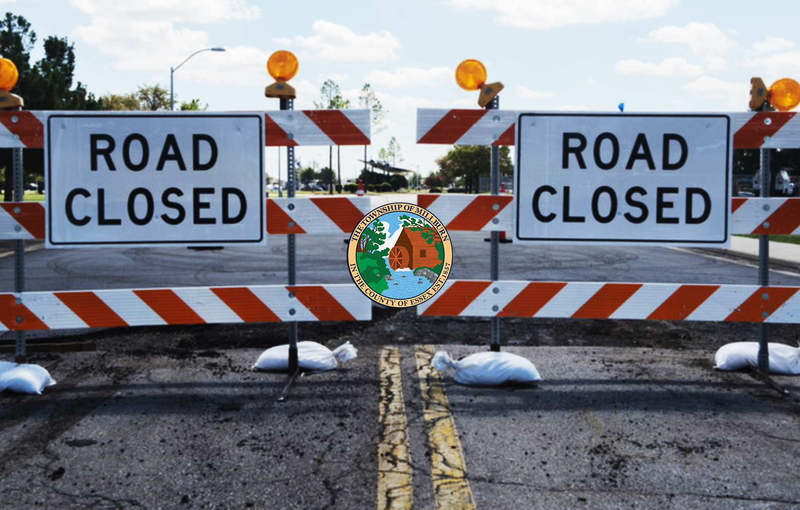 "Image of road blocks with signs that say ""Road Closed"""